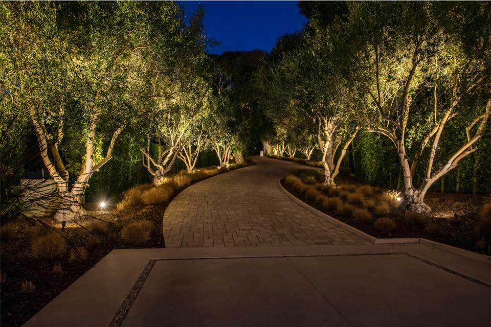 Manicured lawns, lush gardens, paved terraces, gravel pathways