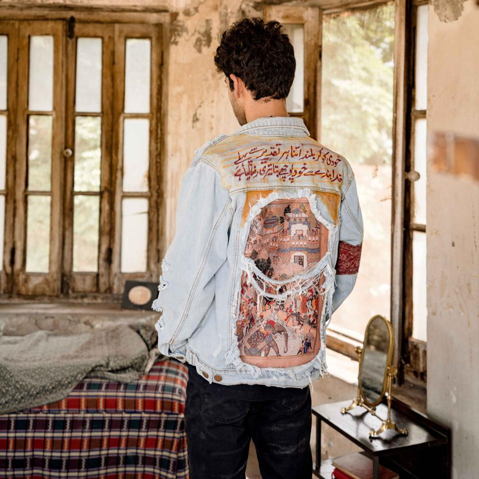 A Rastah jacket featuring Mughal art and a verse by the Pakistani poet, Allama Iqbal.