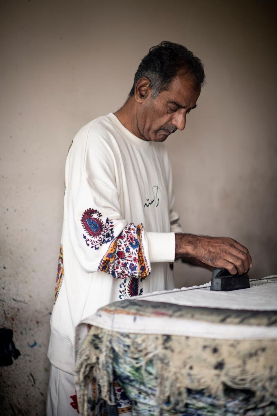 A Rastah artisan at his workshop in Lahore, Pakistan.