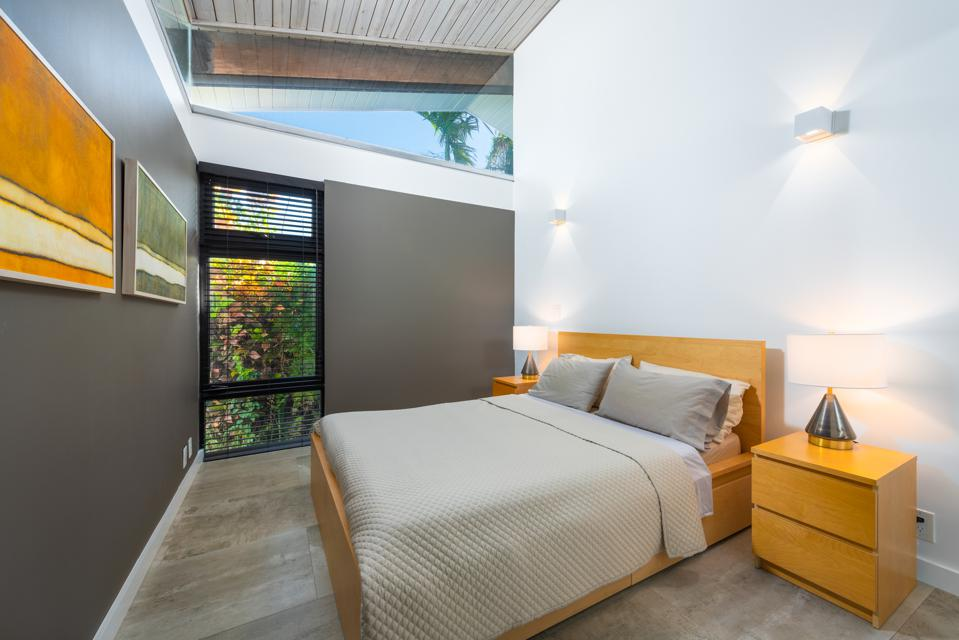 Contemporary bedroom with hurricane blinds
