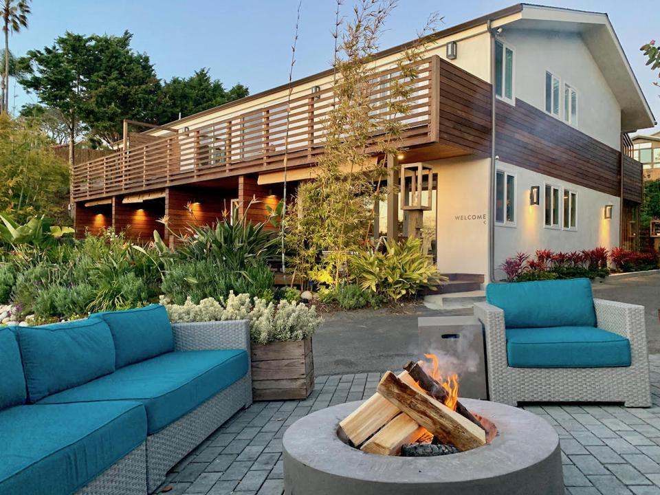 The fire pit and beautiful gardens welcome you to the Inn at Moonlight Beach.