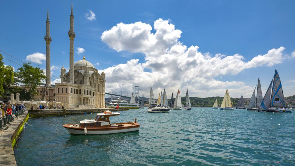 The Ortakoy Mosque and salings yachts in Istanbul,Turkey