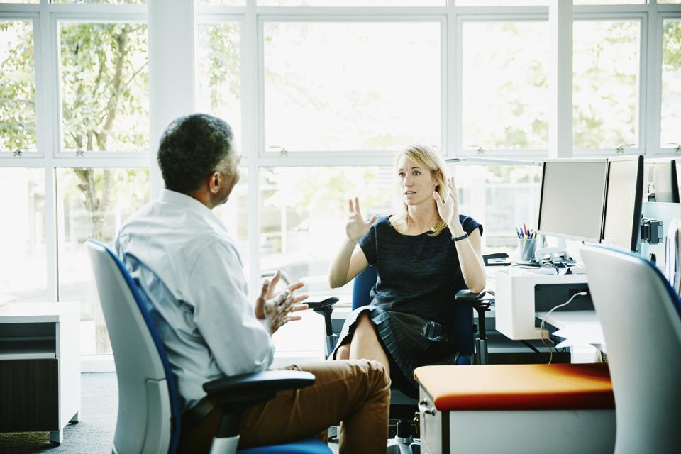 Businesswoman in discussion with coworker