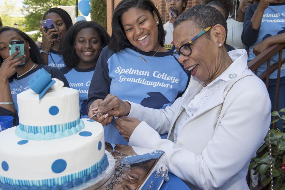 Mary Schmidt Campbell, Ph.D., president of Spelman College, cut the first slice of the cake for Founders Day. This annual tradition celebrates the legacy of New England teachers and missionaries, Sophia B. Packard and Harriet E. Giles, who, after journeying south to study the living conditions of African Americans, pledged to open a school for Black women and girls.