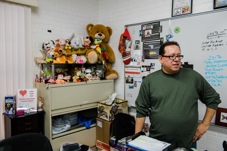 Joseph Gaxiola in his office at the Joshua Tree Feeding Program — a food pantry for the HIV positive community in Phoenix — where he volunteers as chairman.