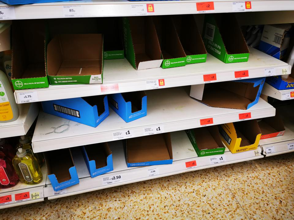 Shelves stripped of surface wipes and hand gel