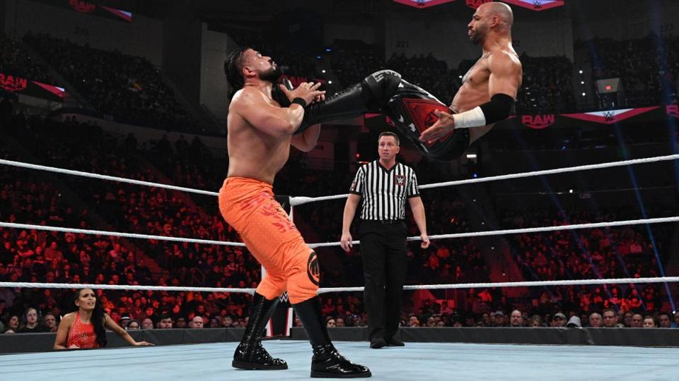 WWE Raw: Ricochet dropkicks Andrade as Zelina Vega looks on