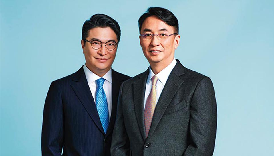 Peter Lee Ka Kit (left) and Martin Lee Ka Shing, the sons of Henderson Land founder Lee Shau Kee, say it's been an eventful time since taking over.