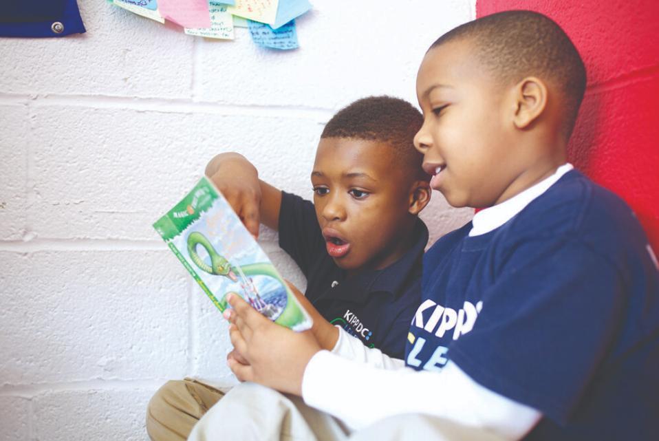 KIPP public charter school students read; benefit from turn around in DC school