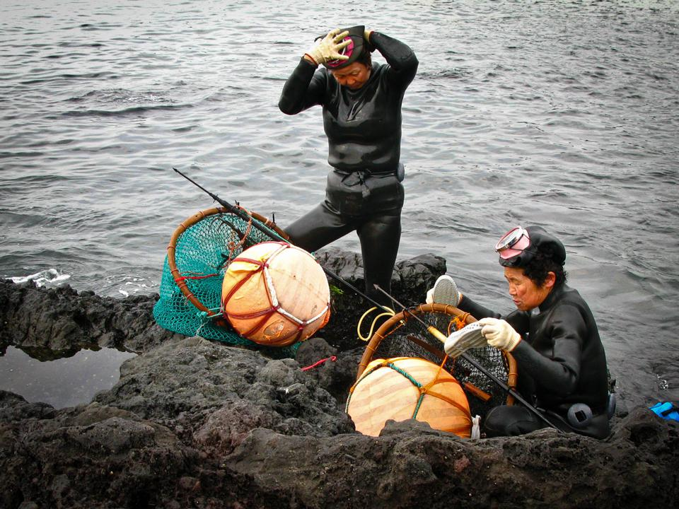 South Korea, Jeju divers, Haenyeo. Fishing in the islands for food.