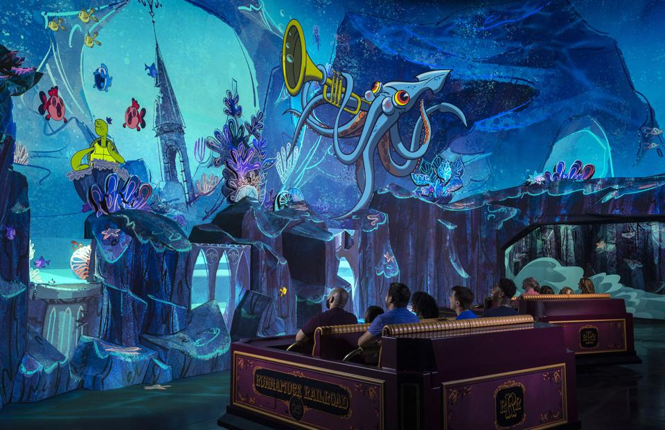 Guests are surrounded by an animated world in Runaway Railway