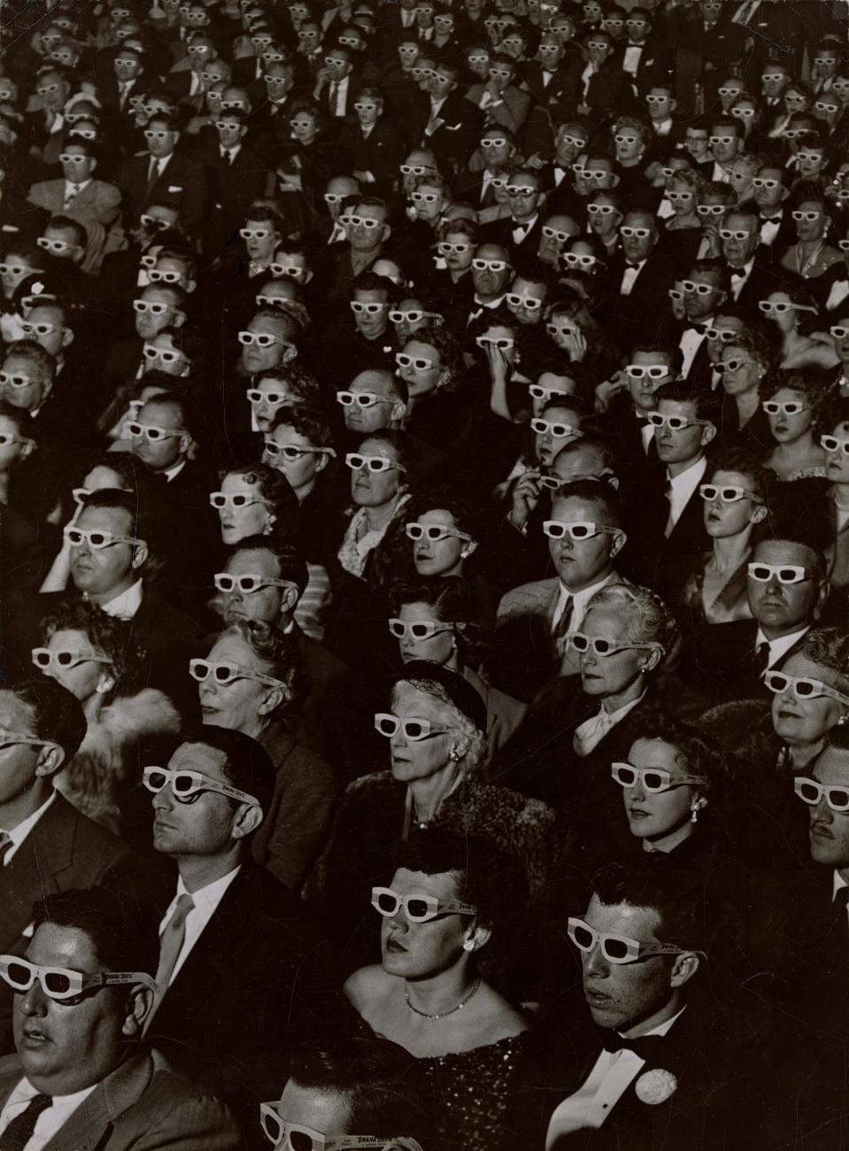 J. R. Eyerman, American, 1906–1985, Audience watches movie wearing 3-D spectacles, 1952. Gelatin silver print. Museum of Fine Arts, Boston, The Howard Greenberg Collection—Museum purchase with funds donated by the Phillip Leonian and Edith Rosenbaum Leonian Charitable Trust. © 1952 The Picture Collection Inc. All rights reserved. Photograph Courtesy Museum of Fine Arts, Boston.