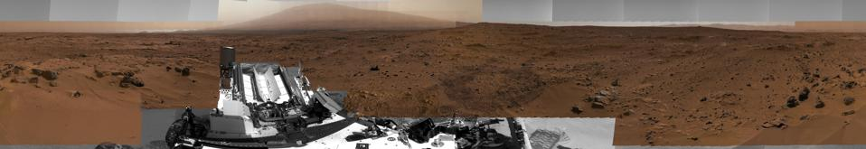 This image is a scaled-down version of a full-circle view which combined nearly 900 images taken by NASA's Curiosity Mars rover. It shows Curiosity at the ″Rocknest″ site where the rover scooped up samples of windblown dust and sand. Curiosity used three cameras to take the component images on several different days between Oct. 5 and Nov. 16, 2012.