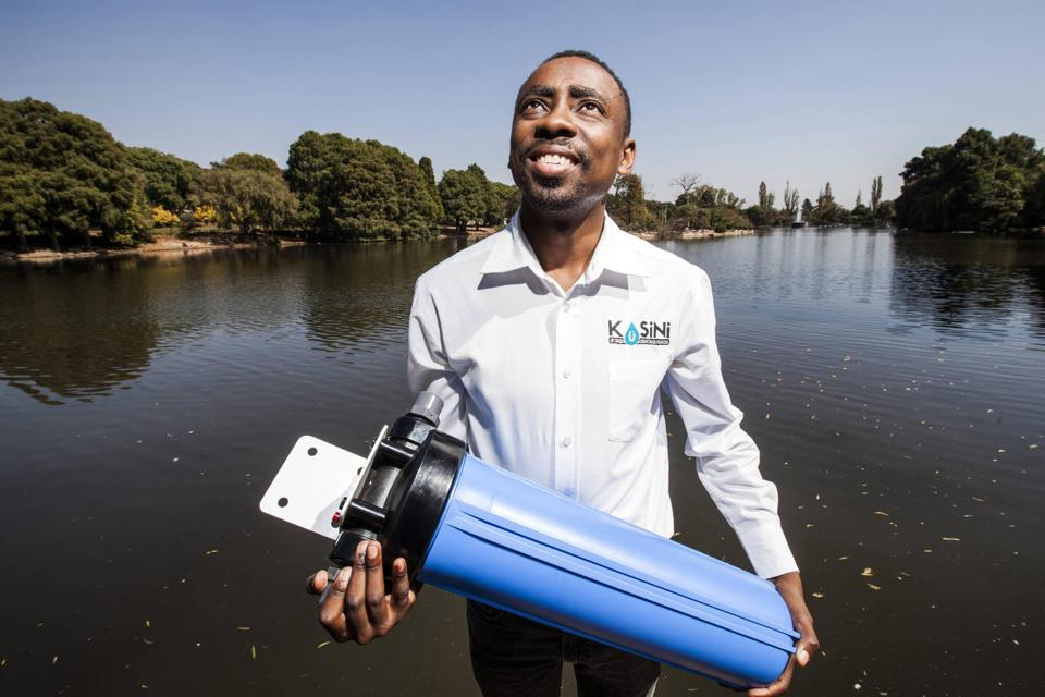 A man holding a water filter