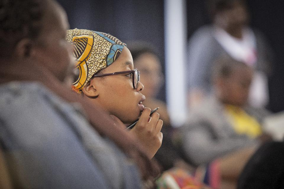 A woman looking thoughtful at an event