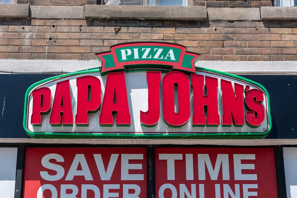 Sign of a Papa John's Pizzeria in the downtown district.