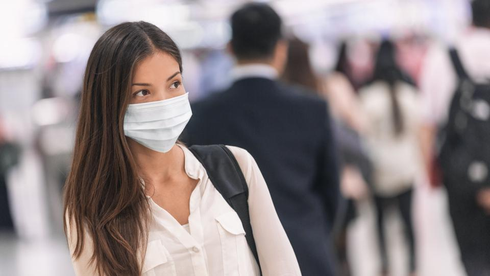 Virus mask Asian woman travel wearing face protection prevention for coronavirus in China.