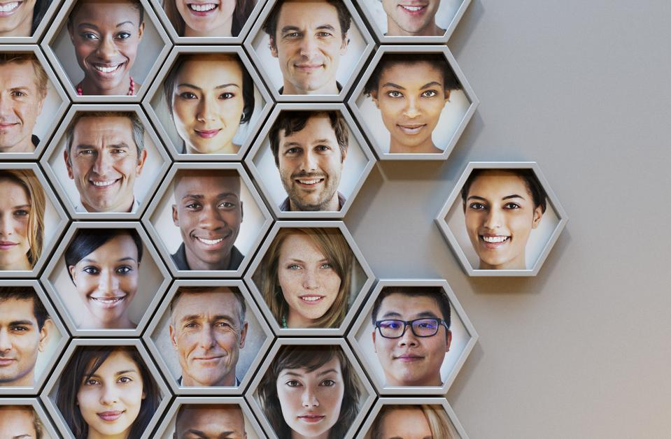 Group of hexagonal portrait pods, different faces representing diverse age, race, gender