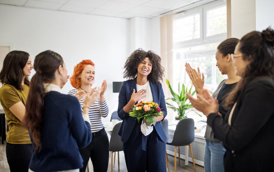 Businesswomen celebrating an achievement of a colleague
