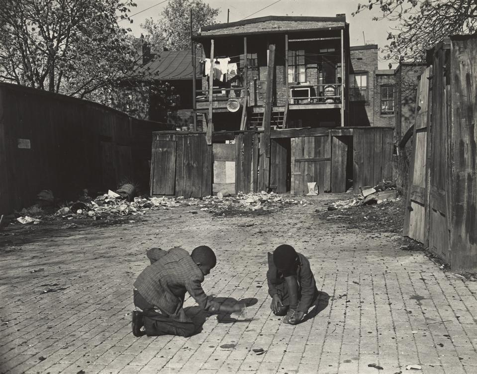 Gordon Parks, 'Washington (southwest section), D.C. Two Negro boys shooting marbles in front of their home,' November 1942. Gelatin silver print, image: 9.2 x 11.7 cm (3 5/8 x 4 5/8 in.), sheet: 10 x 12.4 cm (3 15/16 x 4 7/8 in.). The Museum of Fine Arts, Houston, Museum purchase funded by the Mundy Companies.