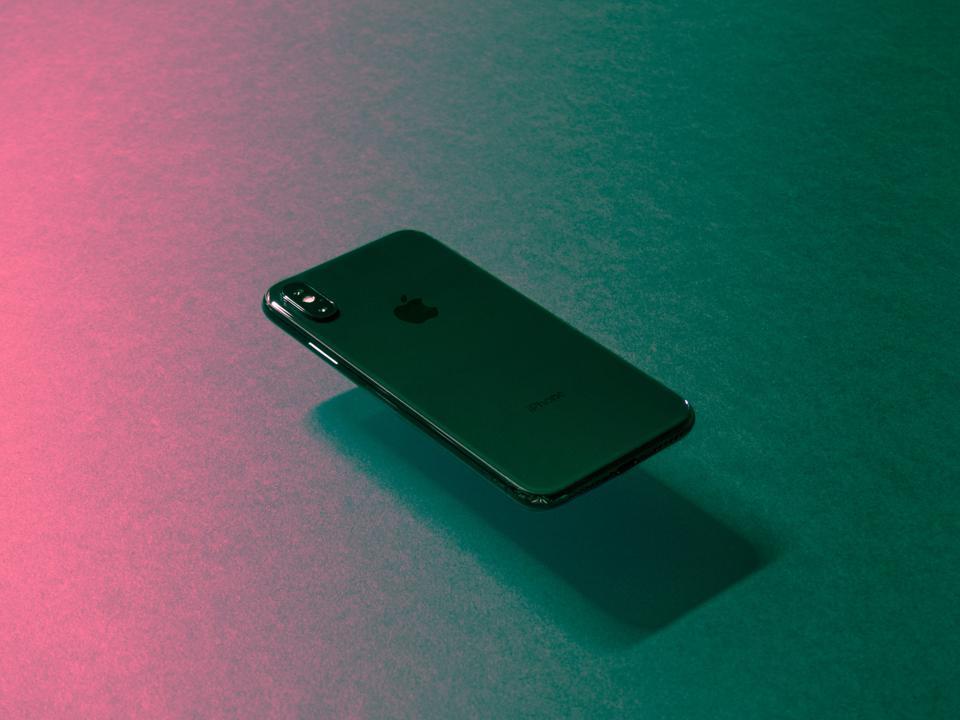 iPhone levitating over background