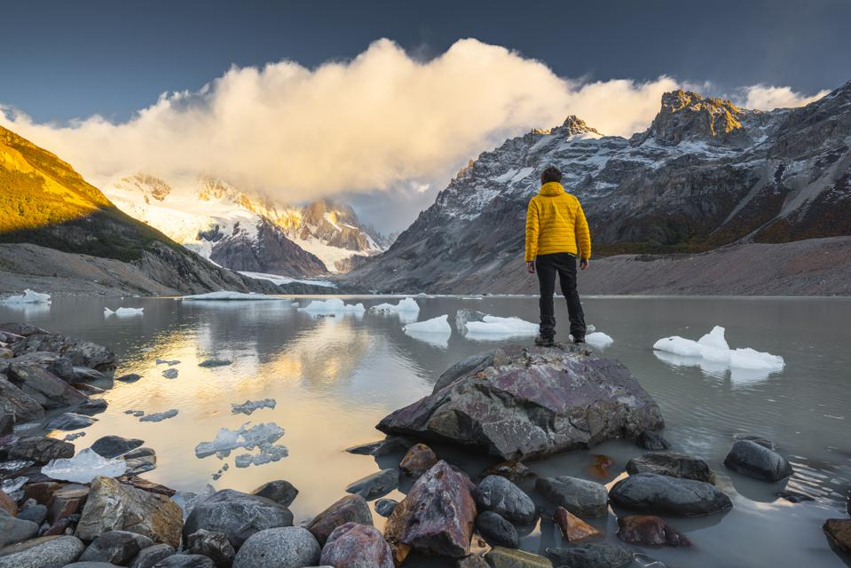 Man looking at view at sunrise in Los Glaciers national park, Argentina