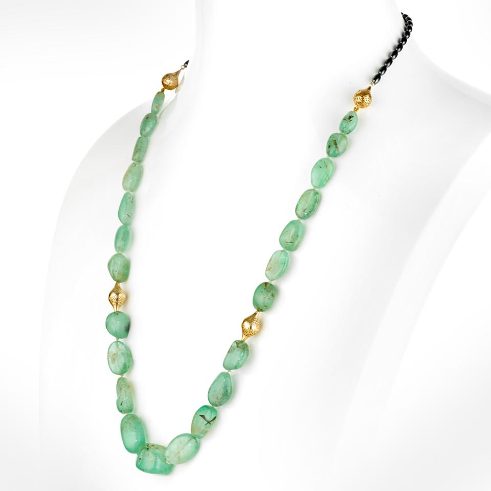 18-karat gold and Russian emerald necklace by New York-based designer Ray Griffiths.