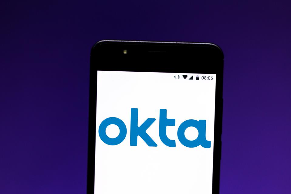 In this photo illustration the Okta logo is seen displayed...
