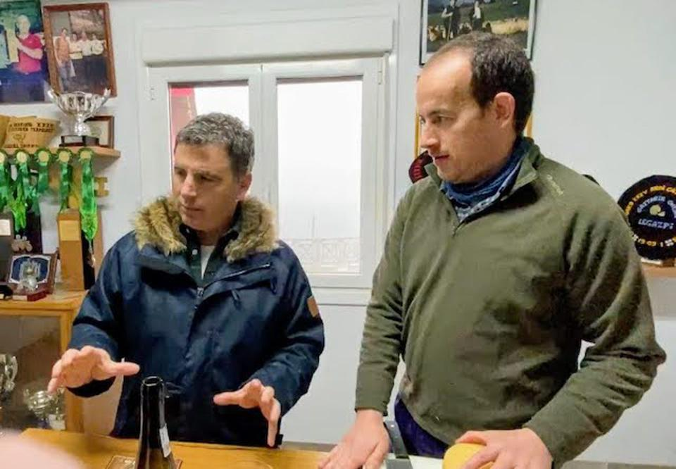 Tour guide Jon Galdos and Inaki Ansola, the eighth-generation owner of the family farm
