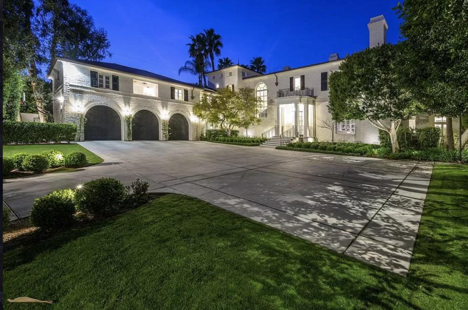 A has three-car garage and motor court make for ample parking.