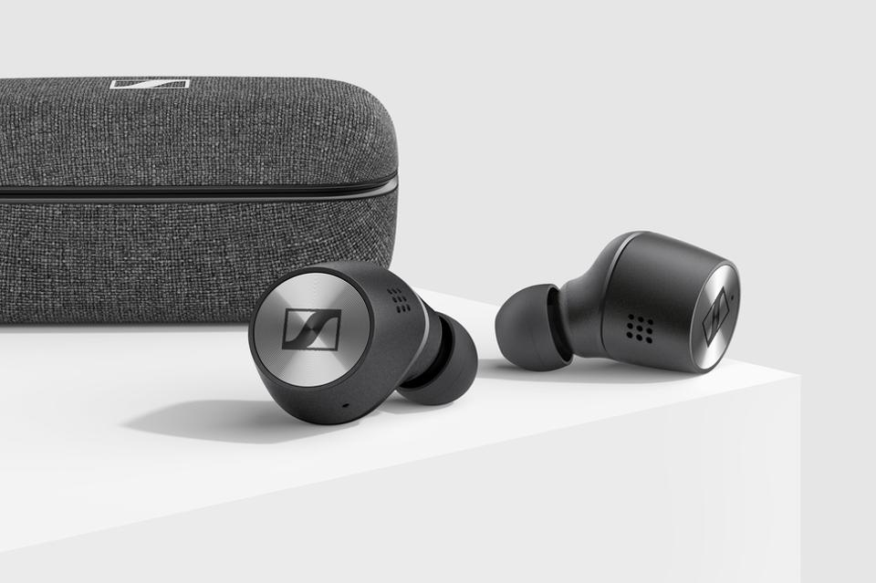 Sennheiser Momentum True Wireless 2 earphones laying next to their charging case