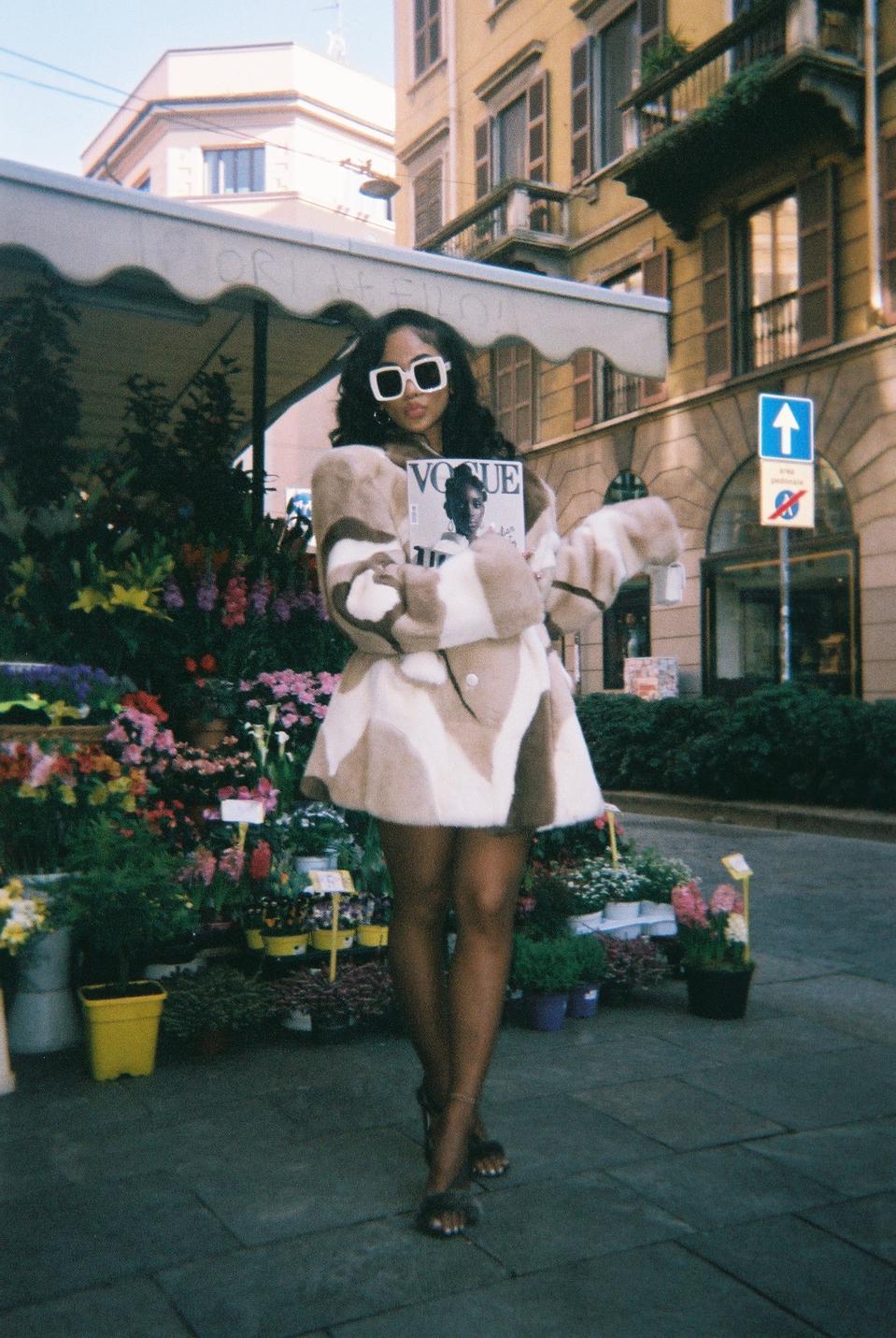 Saweetie holding Vogue Magazine in front of flower shop in Milan - during Milan Fashion week