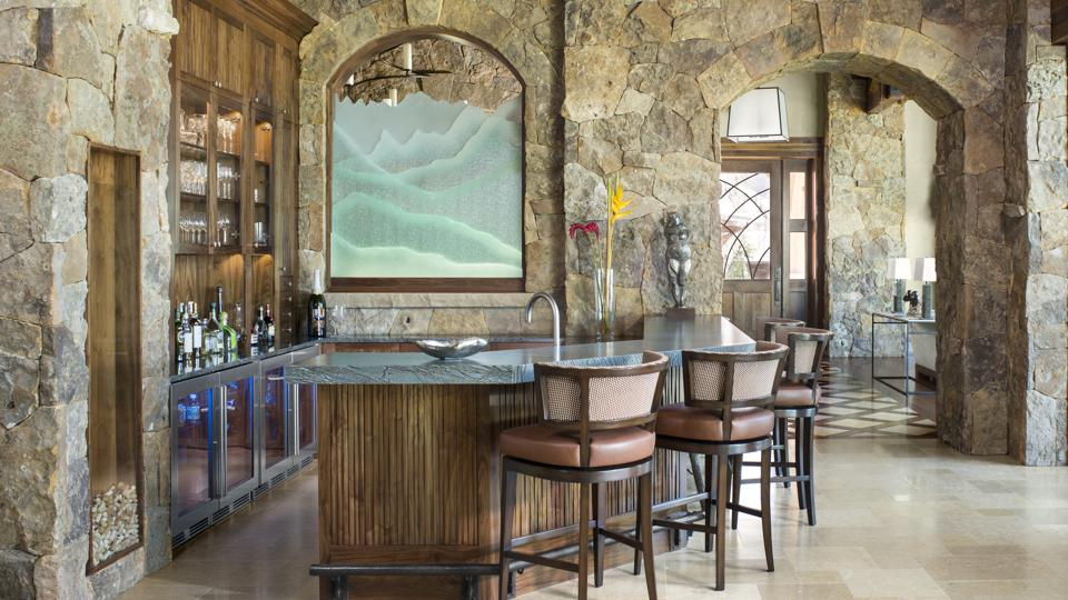 Home bar with mountain views and mountain-style design.