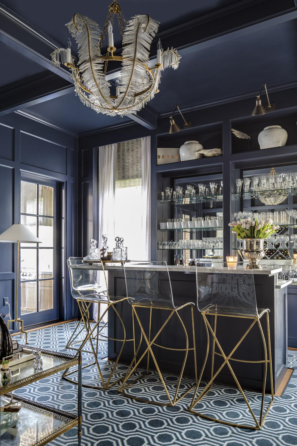 Home bar with blue lacquered walls and gold accents.