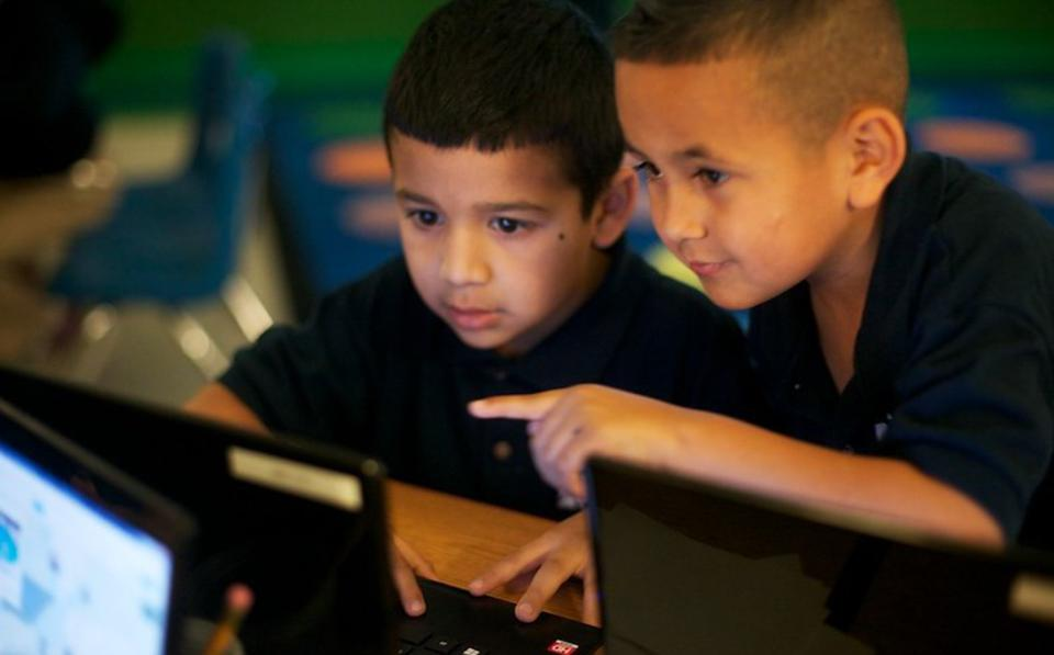 KIPP public charter school students learn using computers and WiFi - during coronavirus