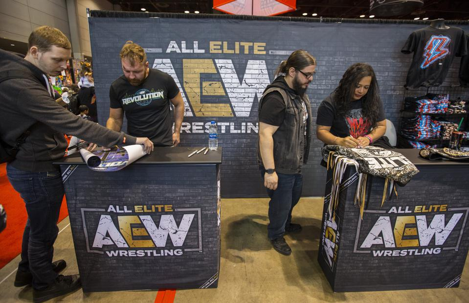 All Elite Wrestling champions Jon Moxley (second from left) and Nyla Rose (right) greet fans at the AEW booth during the C2E2 pop culture convention. Sunday, March 1, 2020 at McCormick Place in Chicago, IL (Photo by Barry Brecheisen)