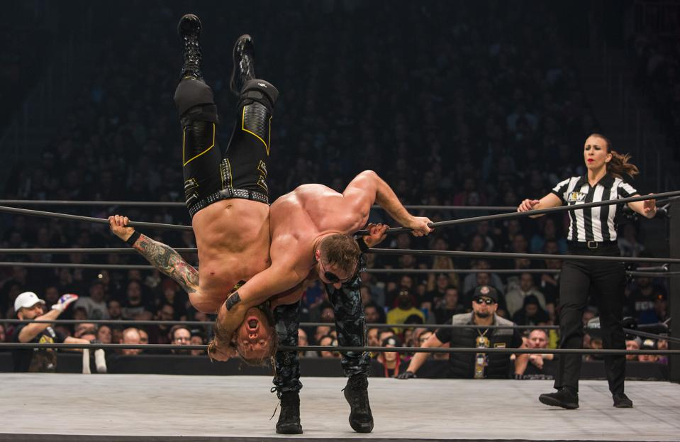 Jon Moxley clothelines Chris Jericho during the main event at All Elite Wrestling's Revolution pay-per-view event. Saturday, February 29, 2020 at Wintrust Arena in Chicago, IL (Photo by Barry Brecheisen)