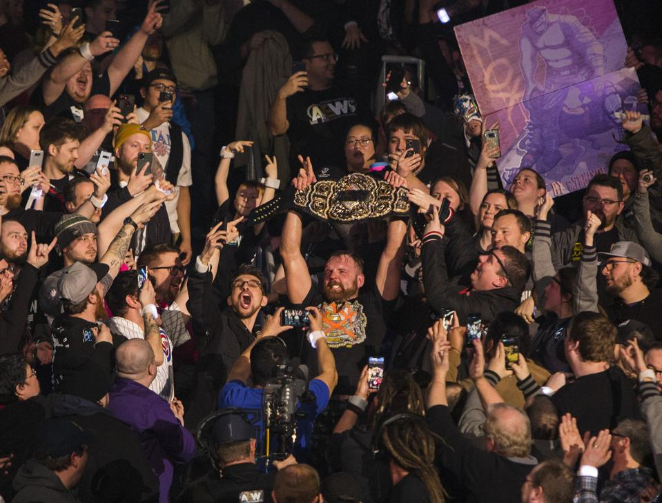 Jon Moxley celebrates as new world heavyweight champion following a victory over Chris Jericho in the main event at All Elite Wrestling's Revolution pay-per-view event. Saturday, February 29, 2020 at Wintrust Arena in Chicago, IL (Photo by Barry Brecheisen)
