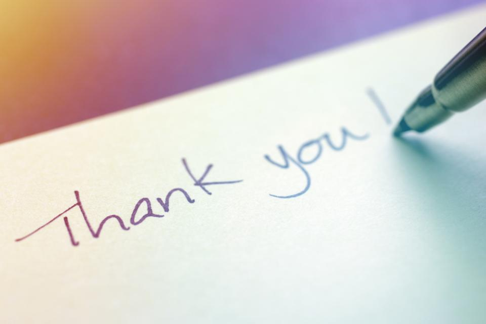Thank You Written with a Pen on Sticky Note
