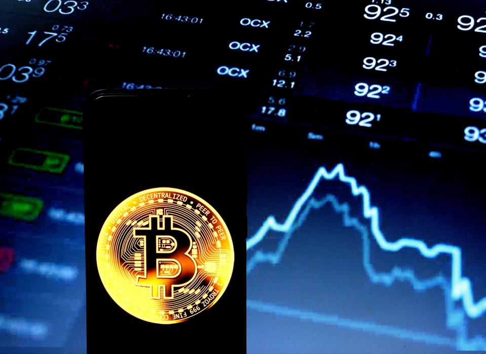 In this photo illustration a popular cryptocurrency Bitcoin...