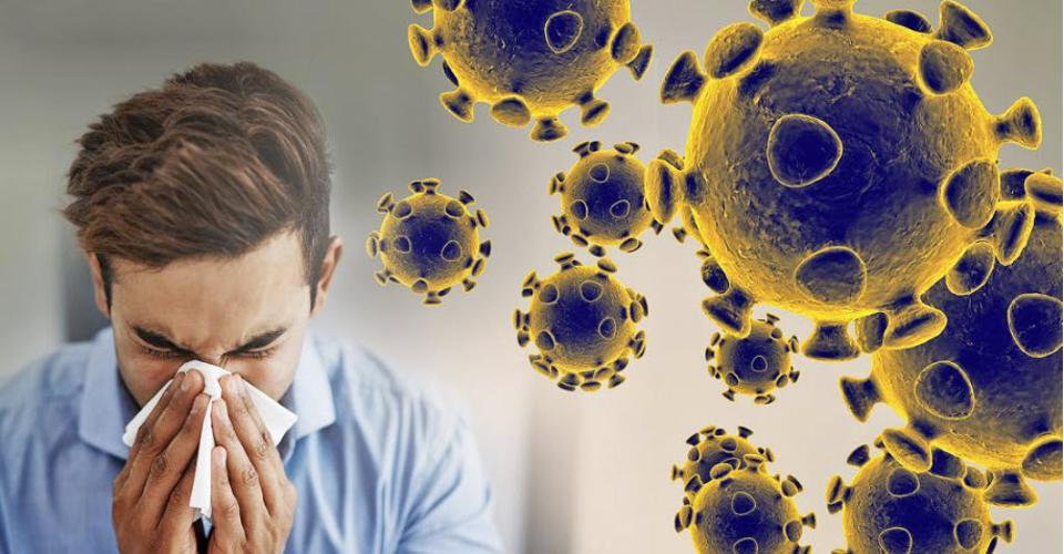 Man sneezing into handkerchief along with depictions of the COVID-19 virus