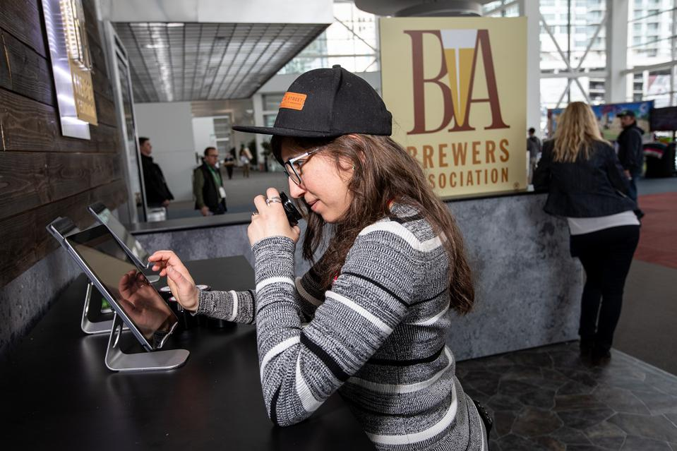 Craft Brewers Conference woman sniffing a beer