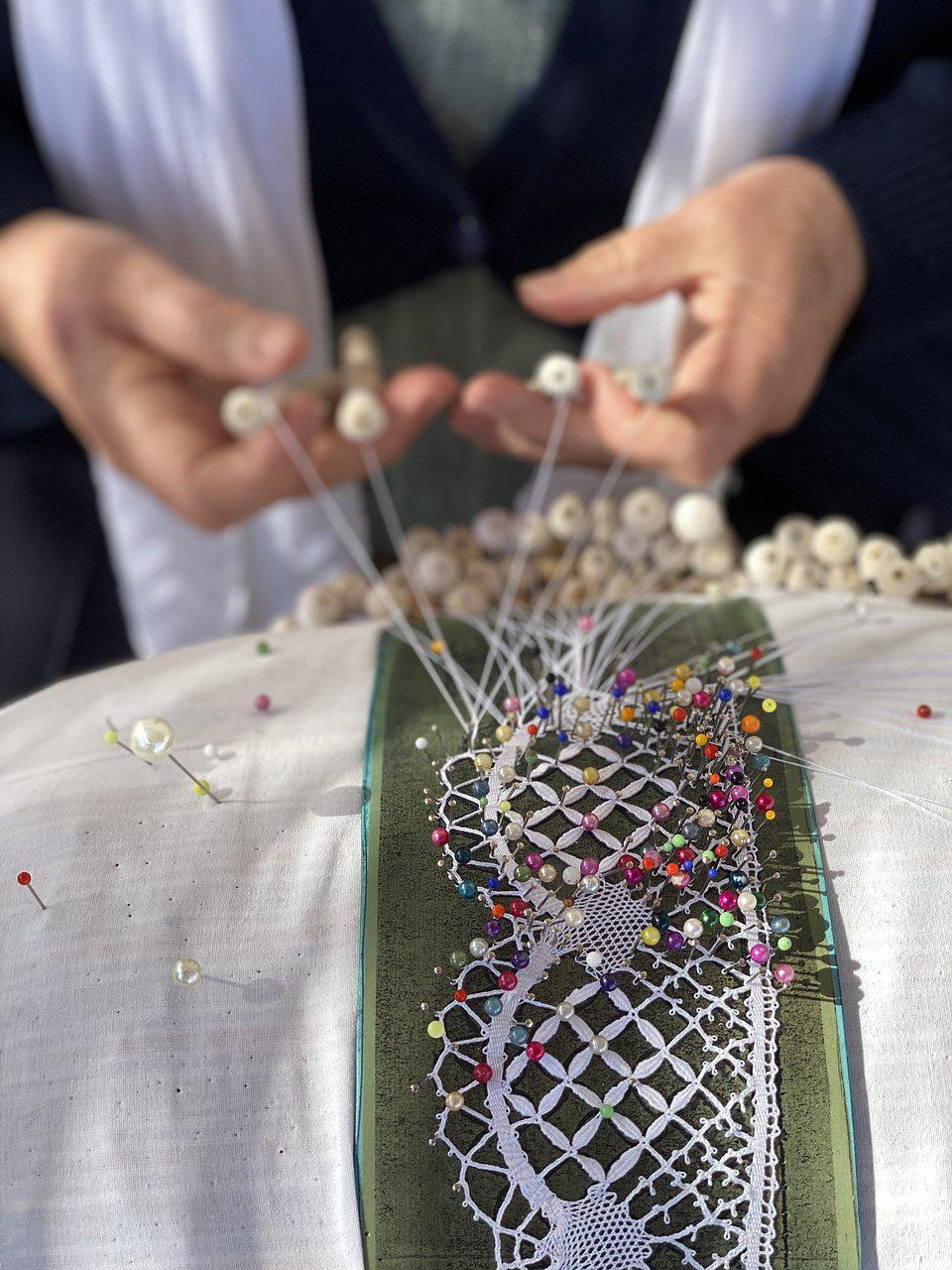 Portuguese bobbin lace' craftswoman