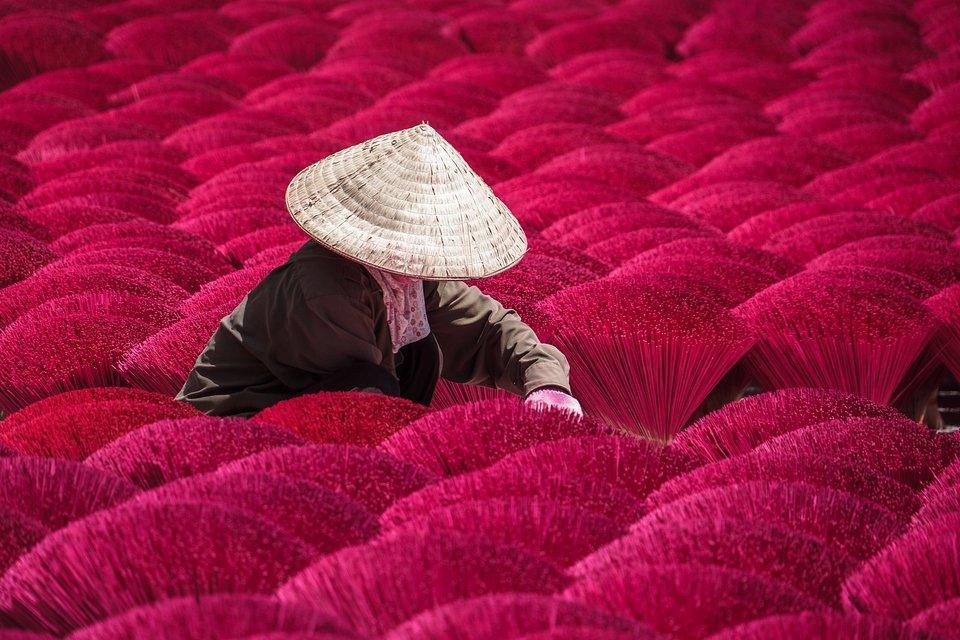 Vietnamese worker making incense