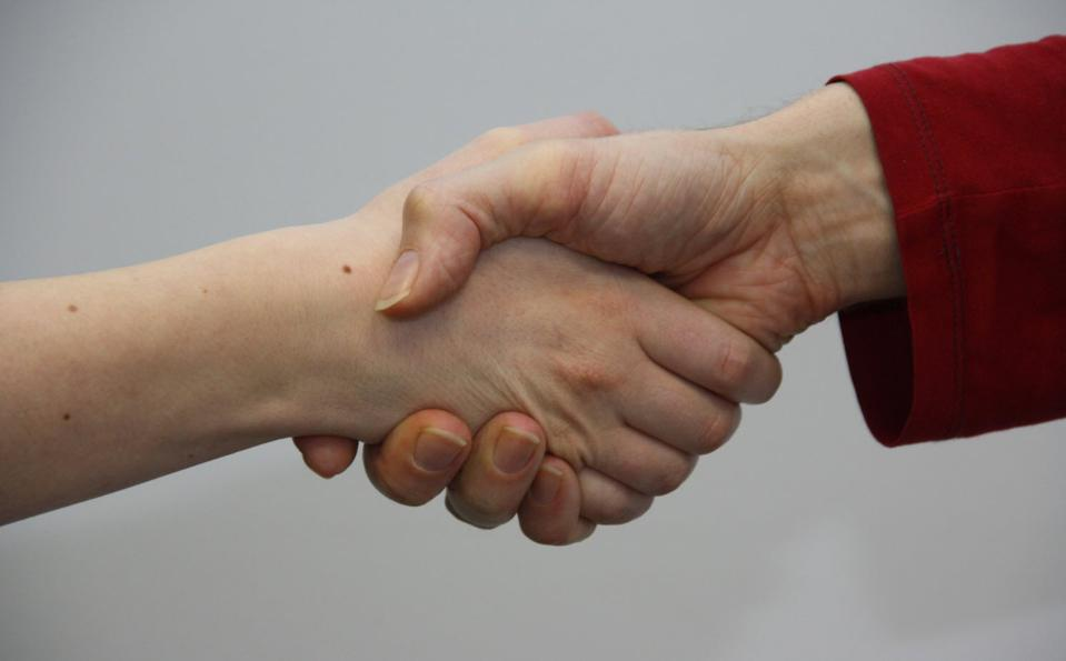 Handshake between a woman and a man