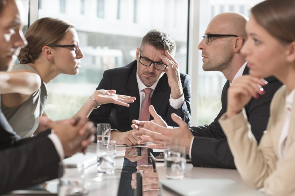 Five business people having an argument