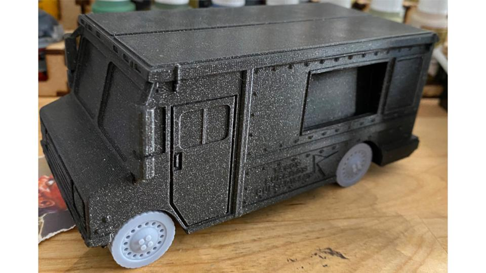 Filament-printed taco truck with resin-printed wheels