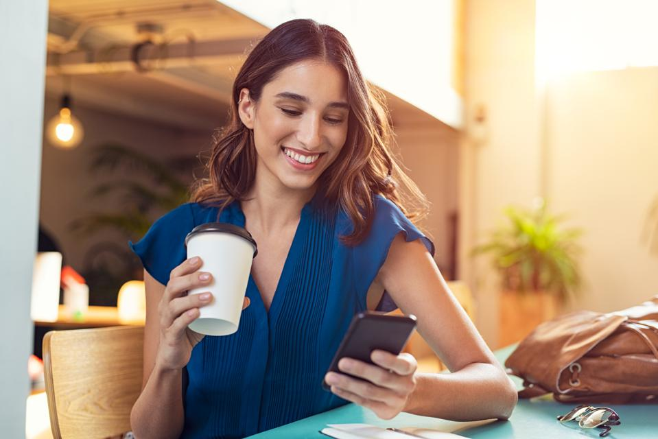 Woman using smartphone to check her email
