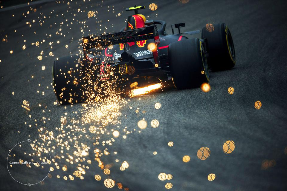 Sparks fly from a Red Bull Racing car in this spectacular shot from ace F1 photographer Darren Heath