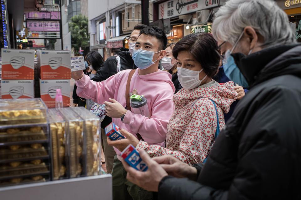 Customers wearing surgical mask buy more masks and alcohol...